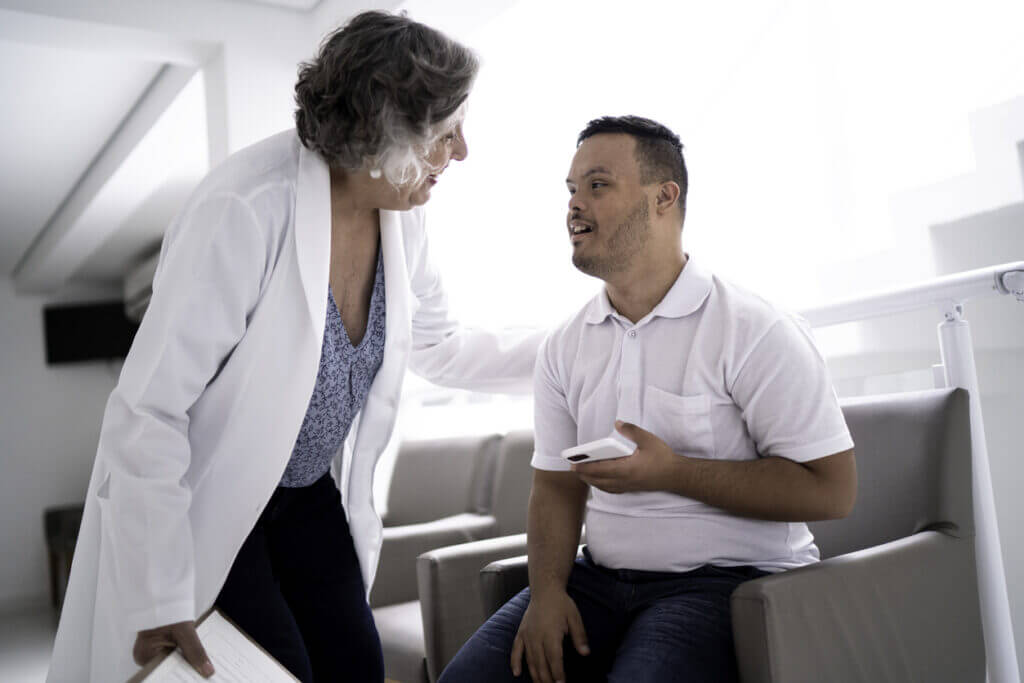 Doctor and patient with Down syndrome